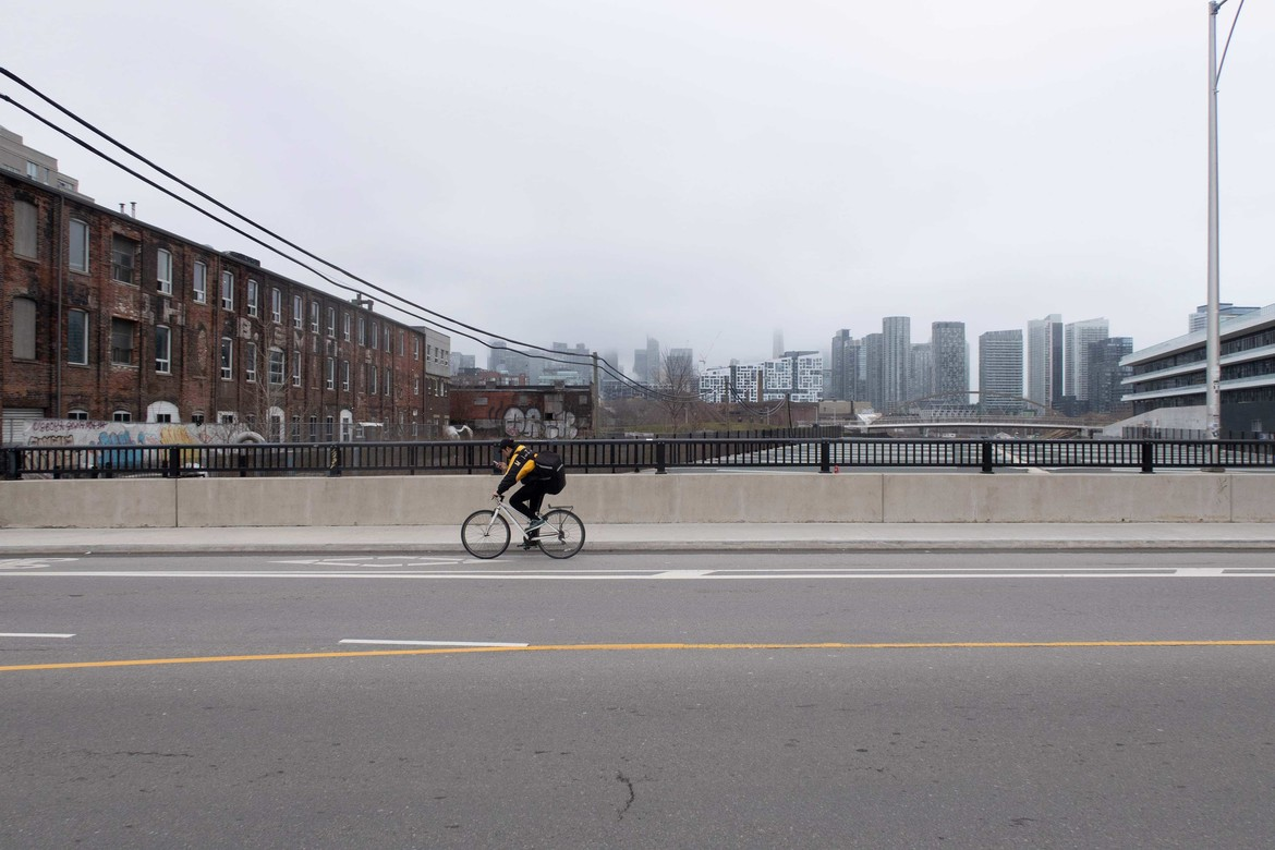 A bike courier working on empty Toronto roads