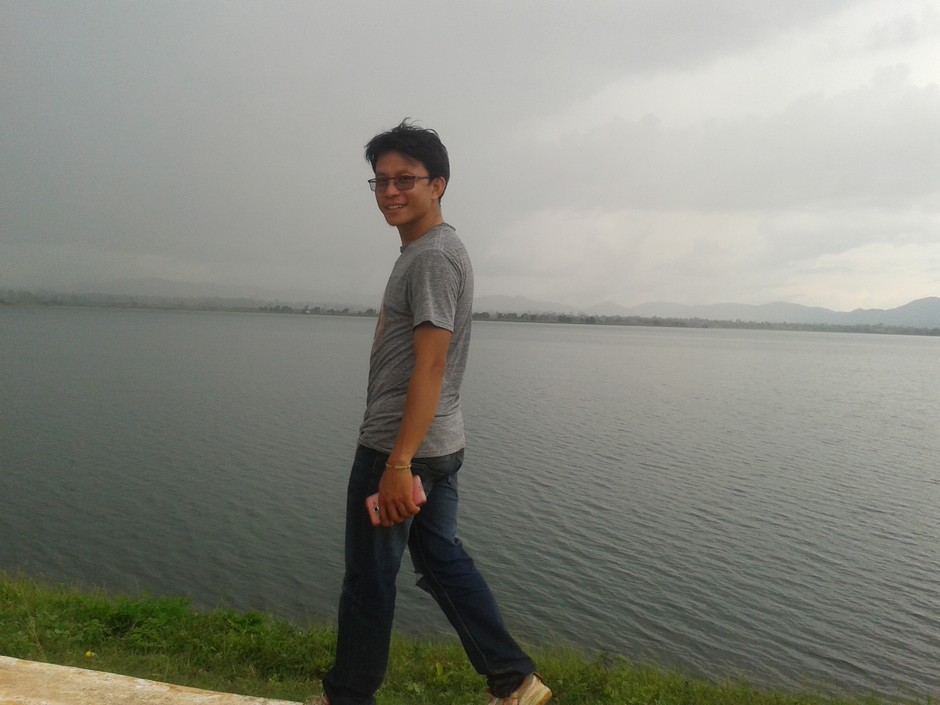 Bede against the background of Loikaw Lake in his home town