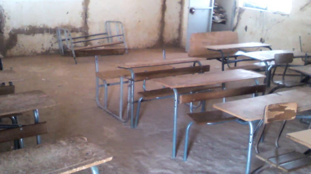 Current state of most of the inside classrooms, broken chairs and earthen.