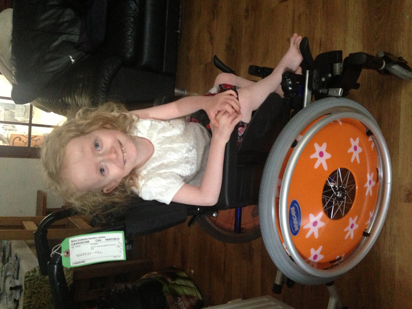 Isabella in her new wheelchair